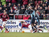 James Collins of Northampton Town is taken down in the box but the referee plays on during the Sky Bet League 2 match between Northampton Town and Wycombe Wanderers at Sixfields Stadium, Northampton, England on the 20th February 2016. Photo by Liam McAvoy.