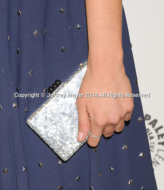 HOLLYWOOD, CA- MARCH 22: Actress Nina Dobrev (handbag, ring detail) at the 2014 PaleyFest - 'The Vampire Diaries' & 'The Originals' held at Dolby Theatre on March 21, 2014 in Hollywood, California.