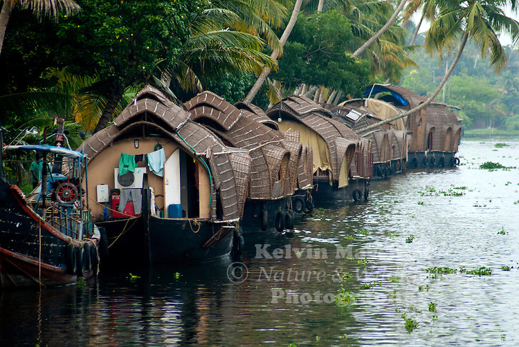 kettuvallom' in the local language meaning `knotted boat', the modern day houseboat is a reincarnation of the traditional canoe used to transport items of daily home use from the mainland to homes cut away by the winding waterways known as `backwaters' The term backwaters are used to denote a network of canals and waterways stretching two hundred kilometers from Kollam in the south through Alleppey and Kumarakom in Central Kerala up to Kodungaloor.