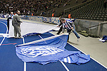 The official team flag-wavers get ready for action before Hertha Berlin take on Sporting Lisbon in the Olympic Stadium in Berlin in a UEFA Europa League group match. Hertha won the match by 1 goal to nil to press to the knock-out round of the cup. 2009/10 was the the first year in which the Europa League replaced the UEFA Cup in European football competition.