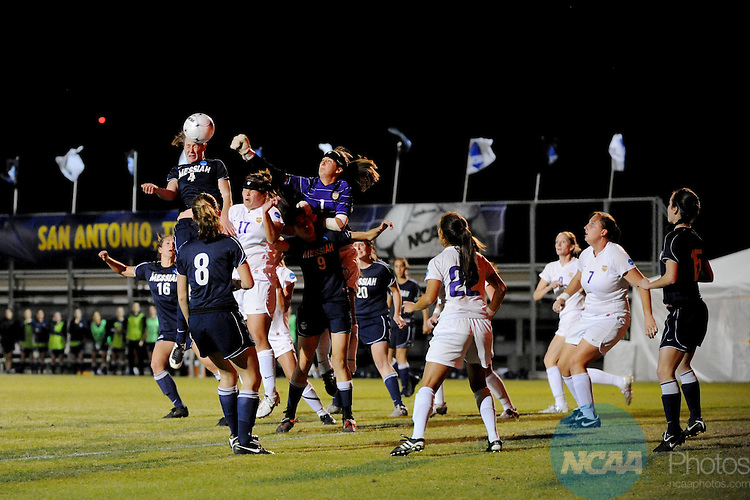 04 DEC 2010: GoalKeeper Rebecca Roth (1) of Hardin-Simmons University punches the ball over Amanda Naeher (4) of Messiah College during the Division III Women's Soccer Championship held at Blossom Soccer Stadium hosted by Trinity University in San Antonio, TX. Hardin-Simmons defeated Messiah 2-1 to win the national title. Brett Wilhelm/NCAA Photos