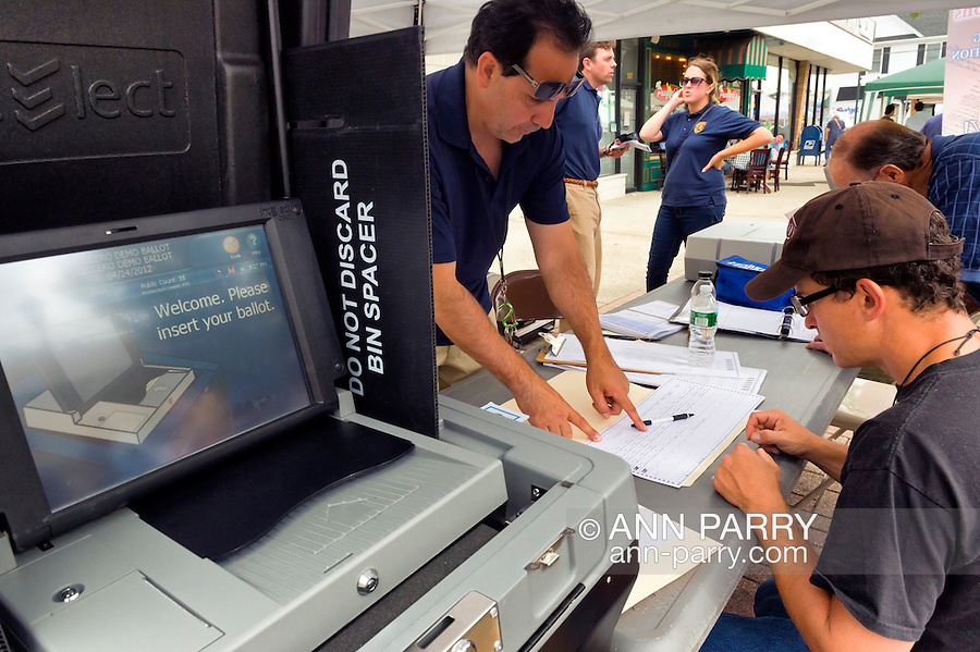 Sept. 22, 2012 - Bellmore, New York U.S. - Nassau County Board of Elections has a new voting machine - a portable electronic voting system - that voters can practice using at booth at the 26th Annual Bellmore Family Street Festival. More people than the well over 120,000 who attended last year are expected, according to the Festival Coordinator.
