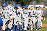 Luke Swenson #26 of the UC Santa Barbara Gauchos greets his teammates after a win against the Cal State Northridge Matadors at Matador Field on May 10, 2013 in Northridge, California. UC Santa Barbara defeated Cal State Northridge, 6-1. (Larry Goren/Four Seam Images)