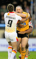 PICTURE BY CHRIS MANGNALL /SWPIX.COM...Rugby League - Super League - Castleford Tigers v Catalan Dragons  - Probiz Coliseum, Castleford, England - 12/03/11...Castleford's Craig Huby  tackled by Catalan's Ian Henderson and Lopini Paea.