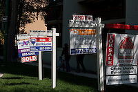 "Maximum realty, Re/Max, Zappia Group realty and Rischuk Park realty ""For sale"" signs are seen next to each other in Winnipeg Thursday May 26, 2011."