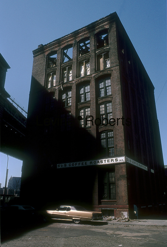 Burnt out warehouse building of S & S Coffee Roasters in the Dumbo neighborhood of Brooklyn in New York, seen in May 1980. The building has been subsequently renovated into residences and the once nameless neighborhood is now trendy. (© Richard B. Levine)