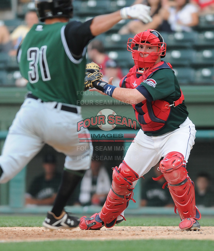 Catcher Christian Vazquez (15) of the Greenville Drive makes the outout at home against Raynor Campbell (31) of the Augusta GreenJackets in a game on April 10, 2011, at Fluor Field at the West End in Greenville, South Carolina. (Tom Priddy / Four Seam Images)