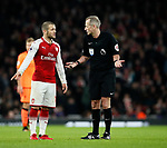 Arsenal's Jack Wilshere argues with referee Martin Atkinson during the premier league match at the Emirates Stadium, London. Picture date 22nd December 2017. Picture credit should read: David Klein/Sportimage