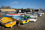 Dinghies on the shore with fishing huts, Orford, Suffolk, England