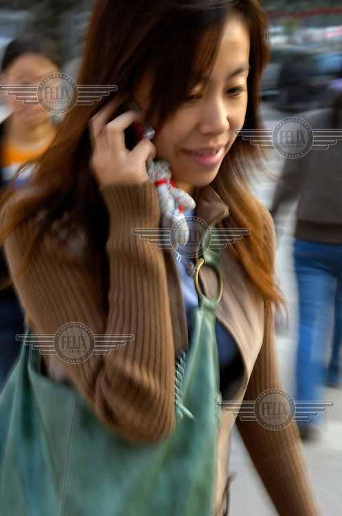 A young woman using a mobile phone.