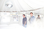 Artists Urs Fischer and Doug Aitken in Urs' fog-filled, disco ball spinnin' yurt.