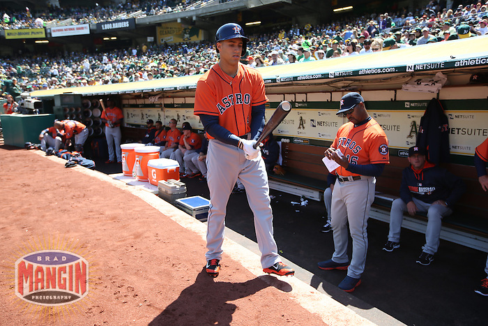OAKLAND, CA - APRIL 19:  George Springer #4 of the Houston Astros stands in front of the dugout before the game against the Oakland Athletics at O.co Coliseum on Saturday, April 19, 2014 in Oakland, California. Photo by Brad Mangin