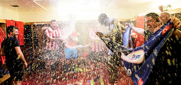 Lincoln City's Matt Rhead, left, sprays champagne as the Lincoln City players celebrate in the changing room after winning the league<br /> <br /> Photographer Chris Vaughan/CameraSport<br /> <br /> The EFL Sky Bet League Two - Lincoln City v Tranmere Rovers - Monday 22nd April 2019 - Sincil Bank - Lincoln<br /> <br /> World Copyright © 2019 CameraSport. All rights reserved. 43 Linden Ave. Countesthorpe. Leicester. England. LE8 5PG - Tel: +44 (0) 116 277 4147 - admin@camerasport.com - www.camerasport.com