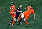 Andres Iniesta (middle), John Heitinga (3) and Mark Van Bommel (6) Soccer, Football - 2010 FIFA World Cup - Johannesburg, South Africa, Sunday, July, 11, 2010. Final match, Netherlands vs Spain, Soccer City Stadium (credit & photo: Pedja Milosavljevic / +381 64 1260 959 / thepedja@gmail.com / STARSPORT )