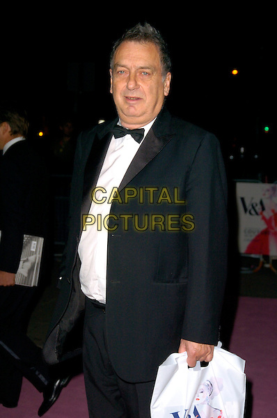 STEPHEN FREARS.Leaving the V & A Golden Age of Couture Gala Victoria and Albert Museum, London, England. .September 18th, 2007 .half 3/4 length black tuxedo bow tie .CAP/CAN.©Can Nguyen/Capital Pictures