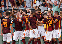 Calcio, Serie A: Roma vs Juventus. Roma, stadio Olimpico, 30 agosto 2015.<br /> Roma&rsquo;s Edin Dzeko, fourth from right, celebrates with teammates after scoring during the Italian Serie A football match between Roma and Juventus at Rome's Olympic stadium, 30 August 2015.<br /> UPDATE IMAGES PRESS/Riccardo De Luca