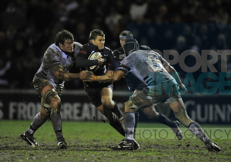 Ben Foden of Sale Sharks tackled by Peter Short and Steve Borthwick of Bath