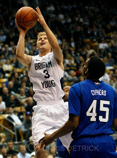 Chris Detrick  |  The Salt Lake Tribune.Brigham Young Cougars guard Tyler Haws (3) shoots past Tennessee State Tigers guard Jordan Cyphers (45) during the second half of the game at the  Marriott Center Friday November 9, 2012.  BYU won the game 81-66.