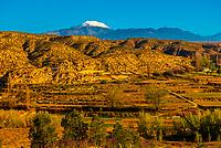 Badlands, with snowcapped La Sagra peak in background, near Galera, Granada Province, Andalusia, Spain.