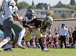 Palos Verdes, CA 09/16/16 - Robert Gutierrez (Torrance #8) and Jeffrey Jimena (Peninsula #6) in action during the Torrance - Palos Verdes Peninsula CIF Varsity football game.