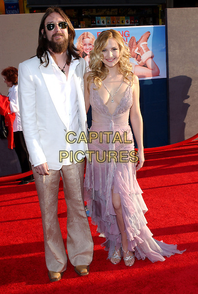 CHRIS ROBINSON & KATE HUDSON.Attend Touchstone Pictures' Los Angeles Premiere of Raising Helen held at The El Capitan Theatre .May 26,2004.full length, full-length, married, celebrity couple, sunglasses, shades, purple flowing, layered dress, plunging neckline.www.capitalpictures.com.sales@capitalpictures.com.©Capital Pictures
