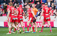 Picture by Allan McKenzie/SWpix.com - 04/03/2017 - Rugby League - Betfred Super League - Salford Red Devils v Warrington Wolves - AJ Bell Stadium, Salford, England - Salford's Kriss Brining is congratulated on scoring a try against Warrington.