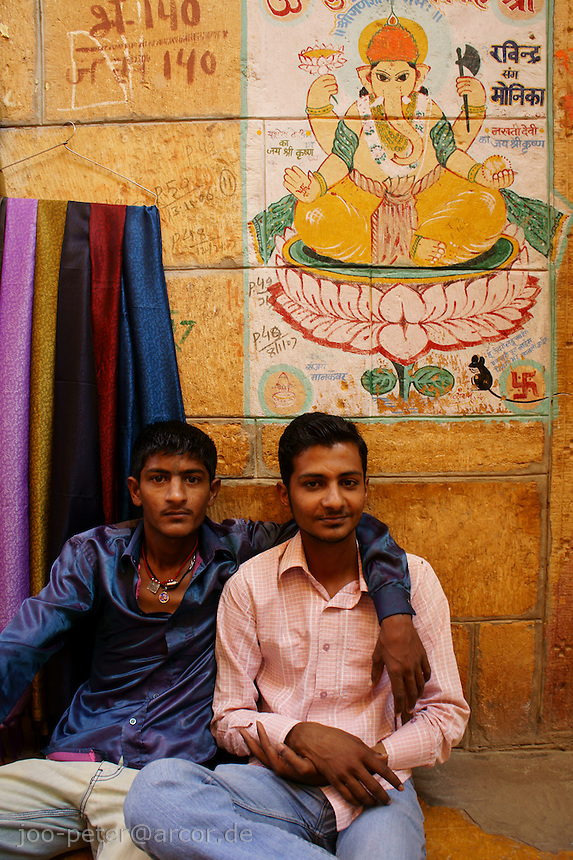 friends in front of their shops in Jaisalmer Fort, Rajastan, India