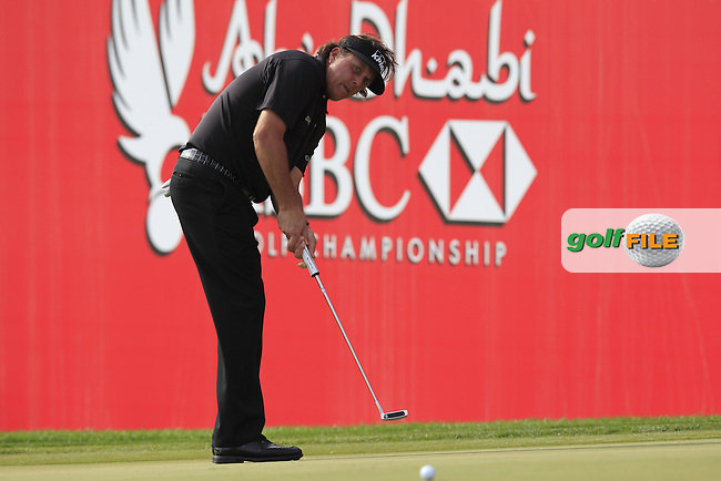 Phil Mickelson (USA) putts on the 18th green during Sunday's Round 3 of the Abu Dhabi HSBC Golf Championship 2014 at the Abu Dhabi Gold Club, Abu Dhabi, United Arab Emirates.19th January 2014.<br /> Picture: Eoin Clarke www.golffile.ie