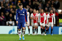 5th November 2019; Stamford Bridge, London, England; UEFA Champions League Football, Chelsea Football Club versus Ajax; A dejected Christian Pulisic of Chelsea as Quincy Promes of Ajax celebrates with team mates as he scores for 1-2 in the 20th minute - Editorial Use