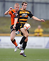 United's Stuart Armstrong and Alloa's Graeme Holmes challenge for the ball.
