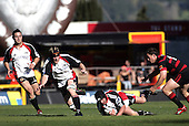 Andrew Van der Heijden is close at hand as Blair Feeney goes to ground during the Ranfurly Shield challenge against Canterbury at Jade Stadium on the 10th of September 2006. Canterbury won 32 - 16.