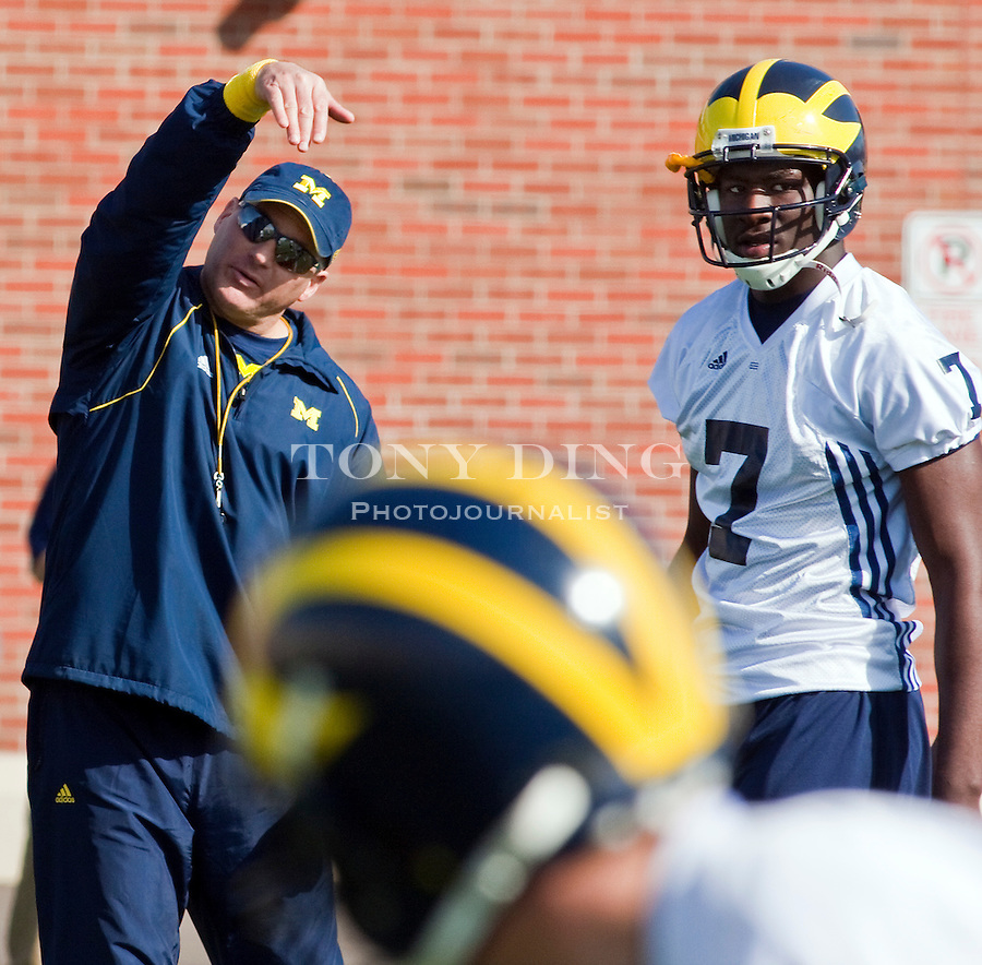 Michigan head coach Rich Rodriguez, left, directs his players during a drill, with freshman quarterback Devin Gardner (7) watching, on the first day of spring football practices, Tuesday, March 16, 2010, in Ann Arbor, Mich. (AP Photo/Tony Ding)