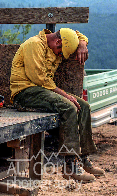 August 31, 1990 El Portal, California  -- Savage Fire – Exhausted tree feller Stan Brent catches a quick nap. The Savage Fire was 1,000 acres.  After the Arch Rock and Steamboat Fires earlier in the month, CDF and US Forest Service wasted no time in stopping the fire. The fire started in the bottom of the Merced River Canyon near the old Savage Trading Post, then ran 1,700 feet up to Ferguson Ridge burning 550 acres of the Sierra National Forest.