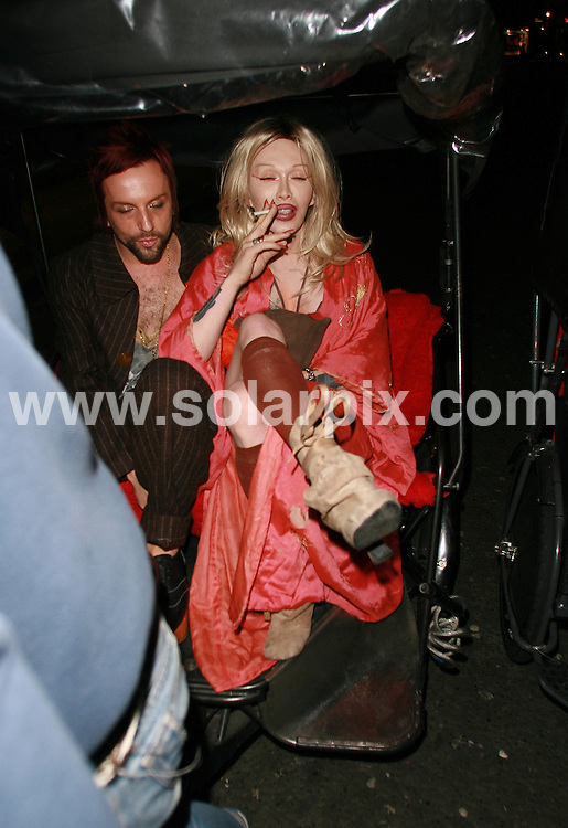 **ALL ROUND PICTURES FROM SOLARPIX.COM**.**WORLDWIDE SYNDICATION RIGHTS**.Pete Burns leaves the world premiere of Basic Instinct 2 held at the Vue Cinema Leicester Square, London. 15th March 2006...JOB REF: 5225 BNE       DATE: 15_03_2006.**MUST CREDIT SOLARPIX.COM OR DOUBLE FEE WILL BE CHARGED* *UNDER NO CIRCUMSTANCES IS THIS IMAGE TO BE REPRODUCED FOR ANY ONLINE EDITION WITHOUT PRIOR PERMISSION*