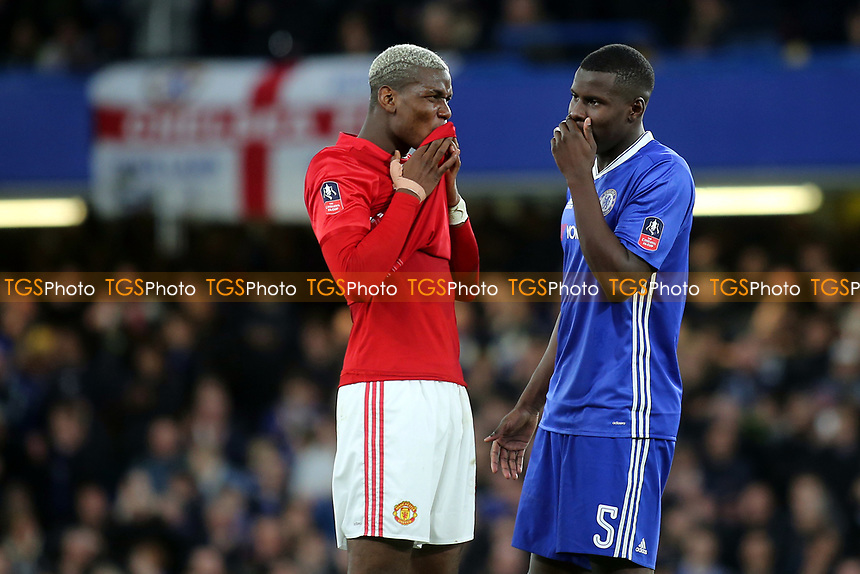 Manchester United's Paul Pogba and Kurt Zouma of Chelsea have a private chat while there was a break in play in the second half during Chelsea vs Manchester United, Emirates FA Cup Football at Stamford Bridge on 13th March 2017