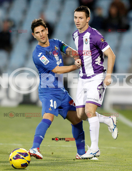 Getafe's Jaime Gavilan (l) and Real Valladolid's Antonio Rukavina during La Liga match.November 18,2012. (ALTERPHOTOS/Acero) NortePhoto
