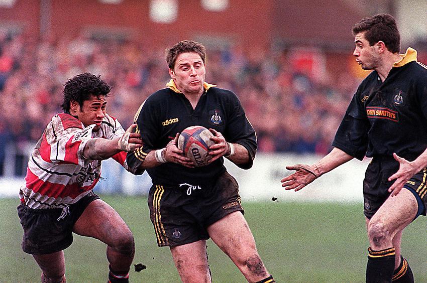 Photo Richard Lane..Gloucester v Newcastle. 11/4/98..Alan Tait attempts to round Terry Fanolua.