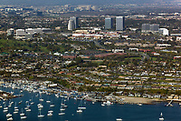 aerial photograph from Corona Del Mar, Newport Beach, toward Newport Center, Orange County, California; in the foreground, the Balboa Yacht Club and the US Coast Guard Cutter, Narwahl.