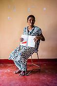 29 year old Vallipurathashan Kunathayalini poses for  photo with her CHDR- Child Health Development Record Card (immunization/vaccination card) in Punaineeravi Village in Kilonochchi, Sri Lanka.  Photo: Sanjit Das/Panos