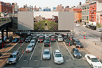 New York, NY -  10 June 2011 Joel Sternfeld photo of the Highline Section C on a billboard adjacient to the Highline, in Chelsea.