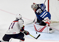 American Dylan Larkin (L) attempts to score past Finnish goalkeeper Harri Sateri during the Ice Hockey World Championship quarter-final match between the US and Final in the Lanxess Arena in Cologne, Germany, 18 May 2017. Photo: Monika Skolimowska/dpa /MediaPunch ***FOR USA ONLY***