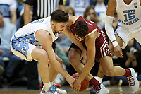 CHAPEL HILL, NC - FEBRUARY 1: Andrew Platek #3 of the University of North Carolina and Derryck Thornton #11 of Boston College fight for a loose ball during a game between Boston College and North Carolina at Dean E. Smith Center on February 1, 2020 in Chapel Hill, North Carolina.