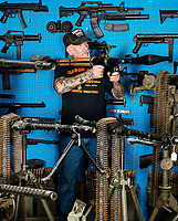 Mel Bernstein, aka Dragonman, at his gun store and shooting range in Colorado Springs, Colorado, Friday, February 19, 2016. Bernstein claims to be the most heavily armed man in Colorado.<br /> <br /> Photo by Matt Nager