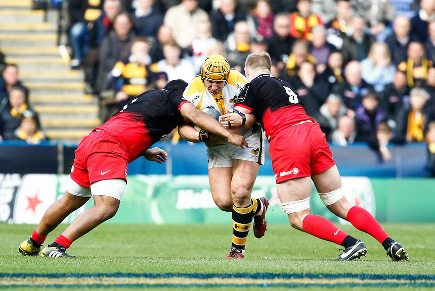 Wasps' Carlo Festuccia is tackled by Saracens' George Kruis<br /> <br /> Photographer Simon King/CameraSport<br /> <br /> Rugby Union - European Rugby Champions Cup Semi Final - Saracens v Wasps - Saturday 23rd April 2016 - Madejski Stadium - Reading<br /> <br /> &copy; CameraSport - 43 Linden Ave. Countesthorpe. Leicester. England. LE8 5PG - Tel: +44 (0) 116 277 4147 - admin@camerasport.com - www.camerasport.com