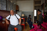 "In the flat of family Matouci in one of the highrise buildings at Lunik IX. Two families are living in this flat, father Matouci explains: ""I worked for 37 years and got educated under the totalitarian regime where everybody had to work. Nowadays nobody likes to give us work because of the color of our skin. Since the Velvet Revolution 1989 none of our governments we had tried to solve the Roma issue (question). My son left for the UK with his family - where he also works - after he was attacked by a bunch of skinheads who almost killed him."" LUNIK IX is populated with almost 100% Roma inhabitans and  in the western-central part of the city of Kosice located in Eastern Slovakia. The living conditions in Lunik IX are partly very bad and many people do not have electricity, water or gas. Some of the buildings are completely devasted."