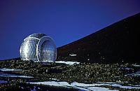 A sparking silver dome housing a huge telescope sits upon the stark landscape of Mauna Kea on the Big Island of Hawaii.