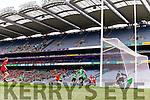 Darran O'Sullivan Glenbeigh Glencar in action against Aidan Girvan Rock Saint Patricks in the Junior Football All Ireland Final in Croke Park on Sunday.