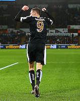 Jamie Vardy of Leicester City celebrates towards Swansea City fans as they mock him after a miss during the Barclays Premier League match between Swansea City and Leicester City played at The Liberty Stadium on 5th December 2015