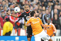 D.C. United forward Santos Maicon (29) heads the ball against Houston Dynamo midfielder Adam Moffat (16) D.C. United tied The Houston Dynamo 1-1 but lost in the overall score 4-2 in the second leg of the Eastern Conference Championship at RFK Stadium, Sunday November 18, 2012.