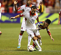Tony Beltran #2 (r) of Real Salt Lake fights for the ball with Dwayne De Rosario #7 of D.C. United during the first half of the U.S. Open Cup Final on October  1, 2013 at Rio Tinto Stadium in Sandy, Utah.